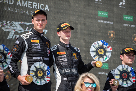 Sandy-Mitchell--Right--on-top-step-of-Road-America-podium-with-Andrea-Amici--copy.jpg