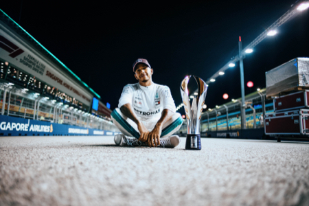 Sitting-with-Trophy.jpg